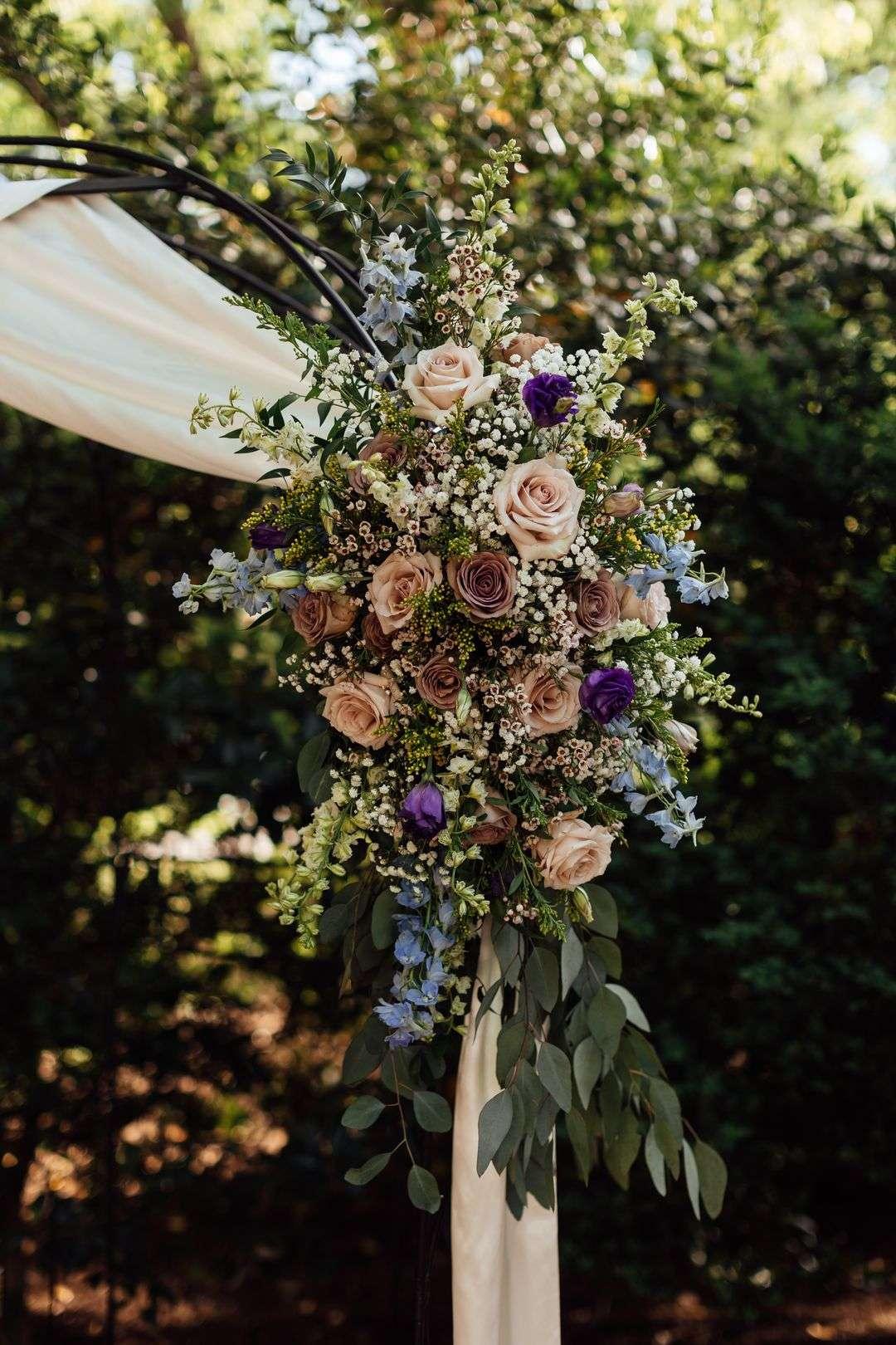 blue and purple wedding arbor