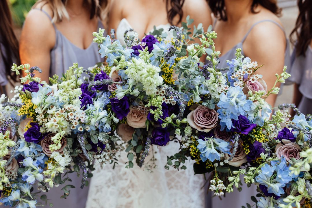blue and purple wildflower wedding bouquets