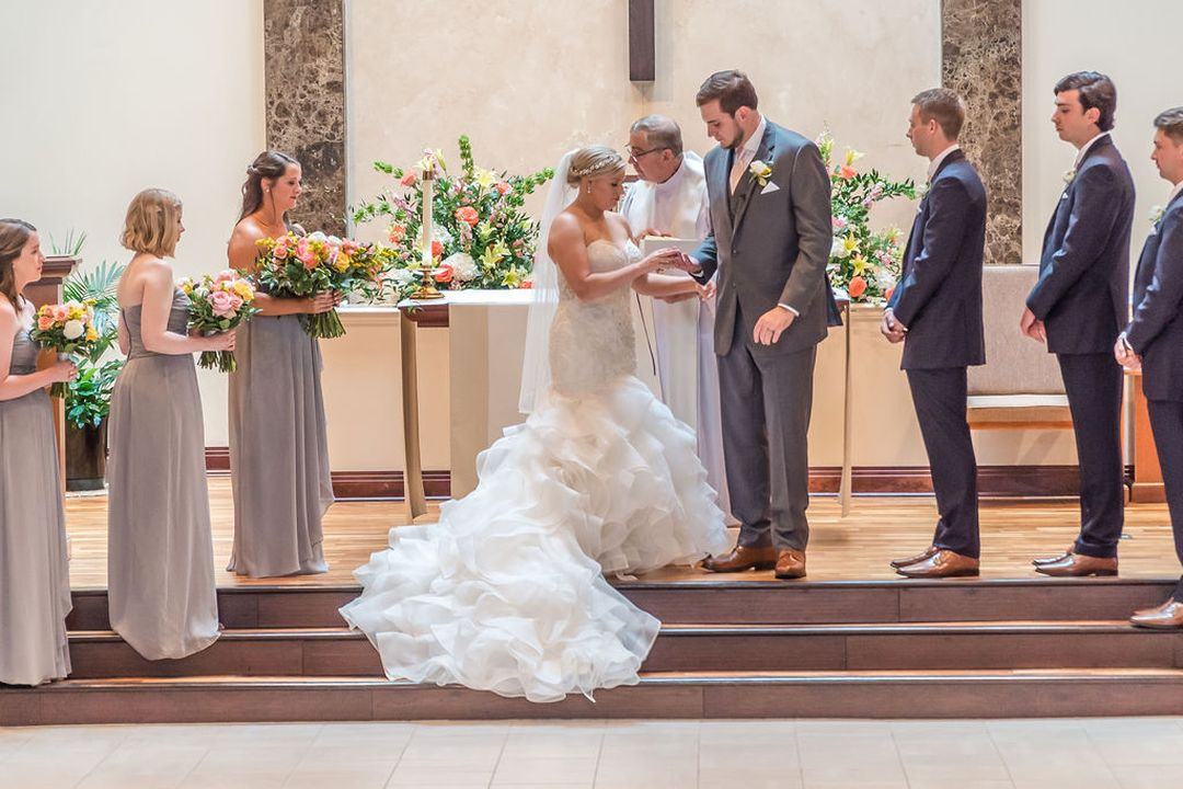 pink and yellow wedding ceremony flowers